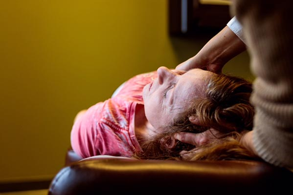 Chiropractic Crown Point IN Patient Getting Adjusted