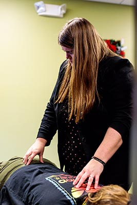 Chiropractor Crown Point IN Kelsi Dimitt and Patient