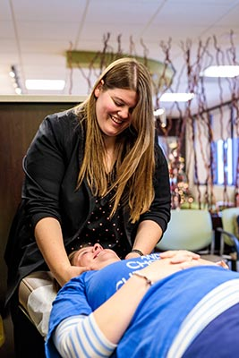 Chiropractor Crown Point IN Kelsi Dimitt with a Patient