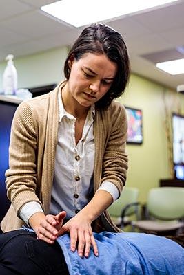 Chiropractor Crown Point IN Kristina Kauffman Focusing on Her Work