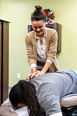 Chiropractor Crown Point IN Kristina Kauffman and Patient