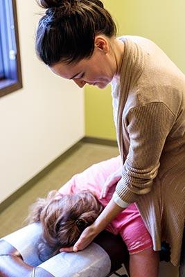 Chiropractor Crown Point IN Kristina Kauffman with Patient