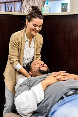 Chiropractor Crown Point IN Kristina Kauffman with a Patient