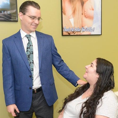 Merrillville Chiropractor Nicholas Kauffman Comforting Patient