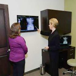 Chiropractor Crown Point IN Danielle Kauffman with Patient